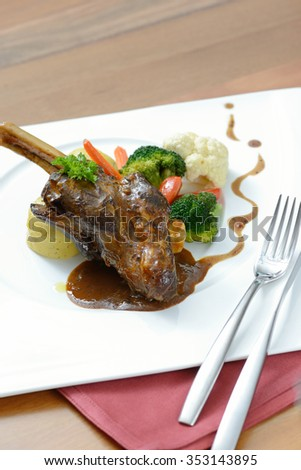 Braised lamb shank and rosemary gravy, with Puree - stock photo