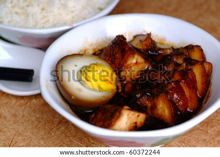 Braised pork serve with white rice - malaysian chinese food - stock photo