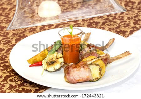 braised ribs calf in sauce with vegetables - stock photo