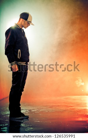 Brake-dancer standing in a smoke - stock photo