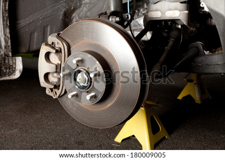 Brake disk and caliper assembly on a modern car about to be replaced - stock photo