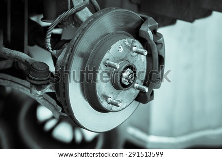 brake disk and detail of the wheel hub - black and white filter effect - stock photo