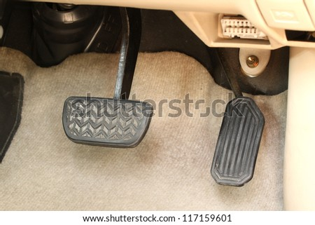 Brake pedal and accelerator - stock photo