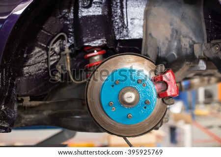 brake repairing in garage  - stock photo