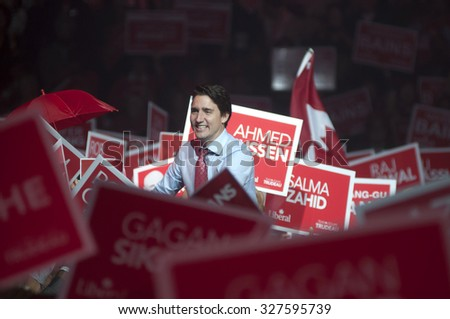 BRAMPTON - OCTOBER 4 :Justin Trudeau shaking hands with his supporters while surrounded by banners  during an election rally of the Liberal Party of Canada on October 4, 2015 in Brampton, Canada. - stock photo