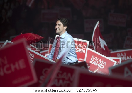 BRAMPTON - OCTOBER 4 :Justin Trudeau shaking hands with the people during an election rally of the Liberal Party of Canada on October 4, 2015 in Brampton, Canada. - stock photo