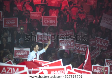 BRAMPTON - OCTOBER 4 :Justin Trudeau waiving towards his followers inside the auditorium during an election rally of the Liberal Party of Canada on October 4, 2015 in Brampton, Canada. - stock photo
