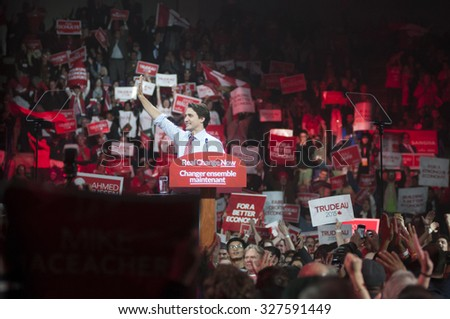 BRAMPTON - OCTOBER 4 :Justin Trudeau waiving towards the  gathering during an election rally of the Liberal Party of Canada on October 4, 2015 in Brampton, Canada. - stock photo
