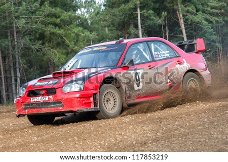 BRAMSHILL FOREST, UK - NOVEMBER 3, 2012: Kevin Rowledge sideways in a WRC spec Subaru Impreza on the Warren stage of the MSA Tempest Rally in Bramshill Forest, UK on November 3, 2012