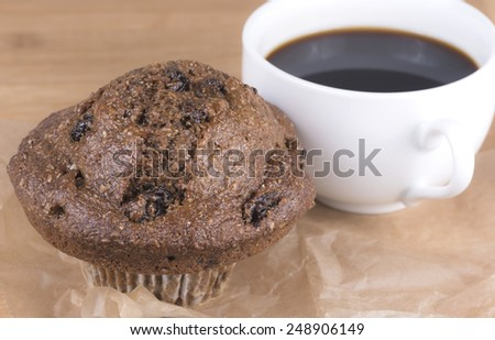 Bran muffin and coffee - stock photo
