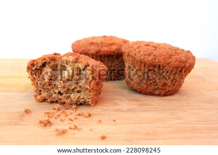 Bran muffins on wooden background - stock photo