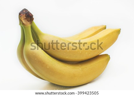 Branch green bananas in water drops isolated on a white background. - stock photo