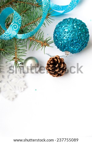Branch of a Christmas tree and blue ball and ribbon Christmas card - stock photo