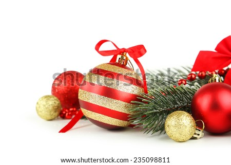 Branch of Christmas tree with balls isolated on white