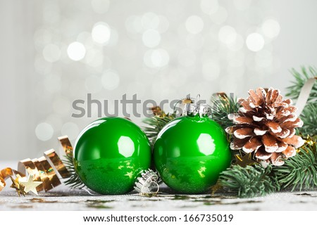 branch of Christmas tree with decoration ball  - stock photo