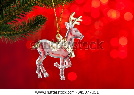branch of Christmas tree with decoration deer