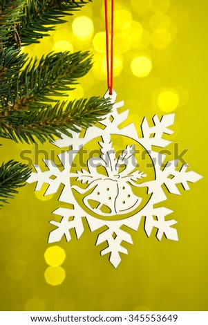 branch of Christmas tree with decoration snowflake  - stock photo