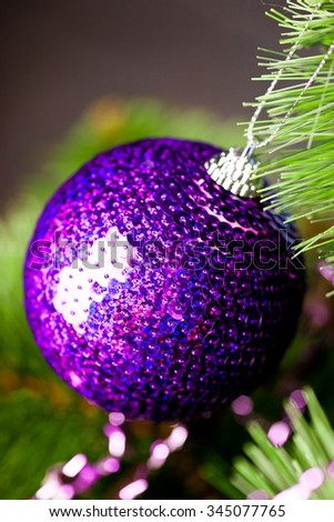 branch of Christmas tree with festive ball - stock photo