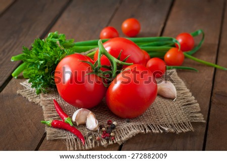 Branch of fresh tomato on  wooden background - stock photo