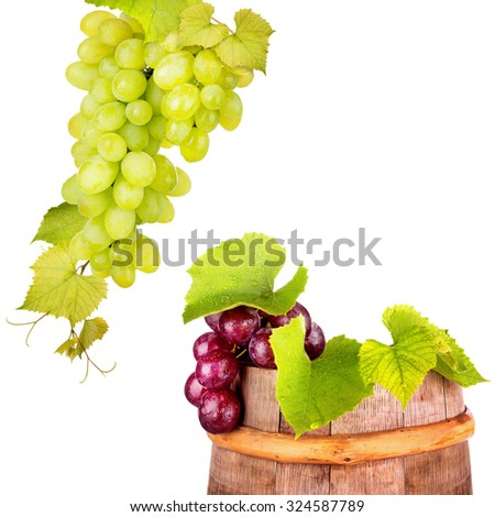 Branch of grape on a wooden vintage barrel on white background - stock photo