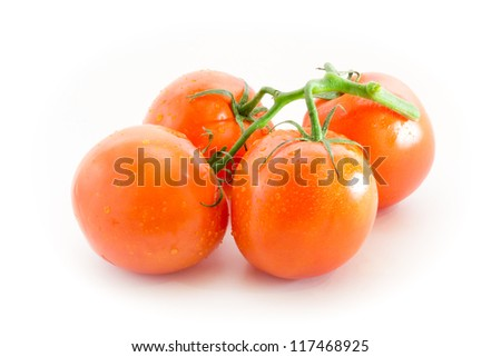 Branch of red tomatoes isolated on white background