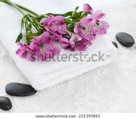 Branch pink orchid ,towel with black stones and white lace  - stock photo