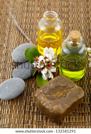 Branch spring flower, candle, massage oil on mat