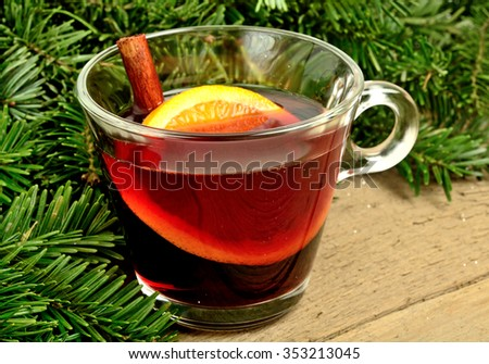 Branch tree and mulled wine on wooden table