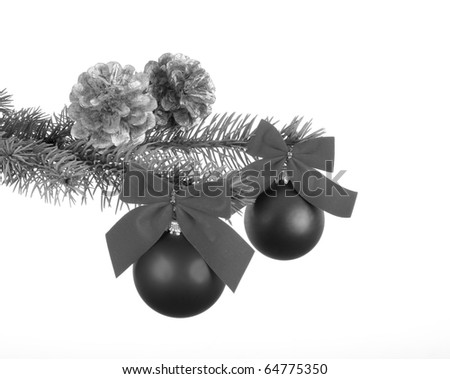 Branch with christmas balls with ribbons, on black and white tone - stock photo