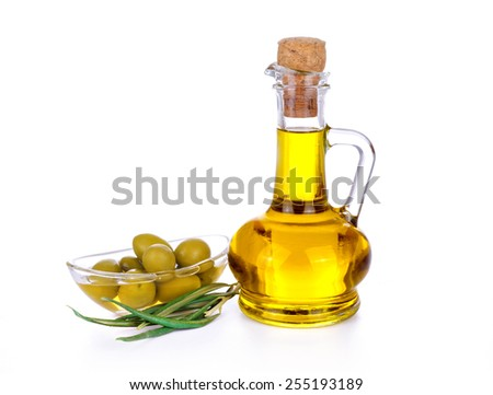 Branch with fresh green olives and a bottle of olive oil, isolated on white background - stock photo