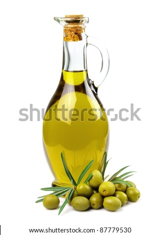 Branch with olives and a bottle of olive oil - stock photo