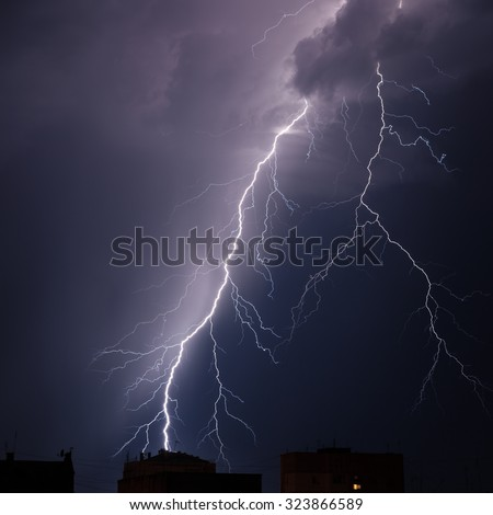 Branched lightning in the night sky - stock photo