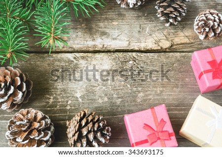 Branches of a Christmas tree on old boards. Christmas background. Christmas decorations. New Year background. Xmax background. Toned image. - stock photo