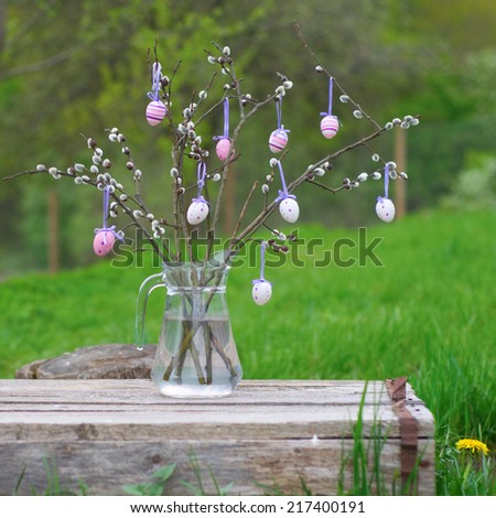 Branches of  pussy willow with easter Eggs - stock photo
