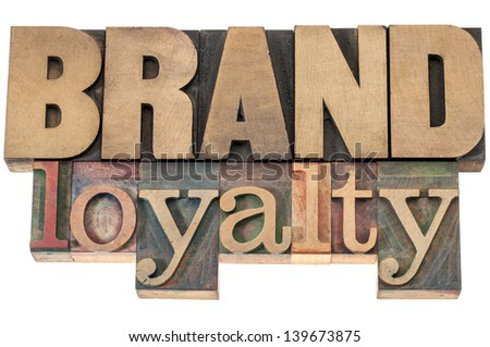 brand loyalty - business concept - isolated text in letterpress wood type printing blocks - stock photo