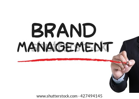 BRAND MANAGEMENT Businessman hand writing with black marker on white background