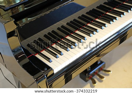 Brand new baby grand piano with keyboard - stock photo