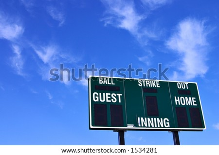 Brand new baseball scoreboard and a brilliant blue sky with wispy clouds. - stock photo