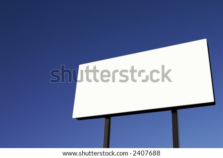Brand new billboard and a pure blue sky - lighter in lower right corner than upper left. - stock photo