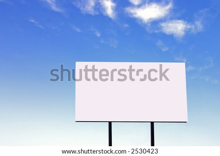 Brand new billboard and a wispy blue sky - larger sign than a similar image in my portfolio - stock photo