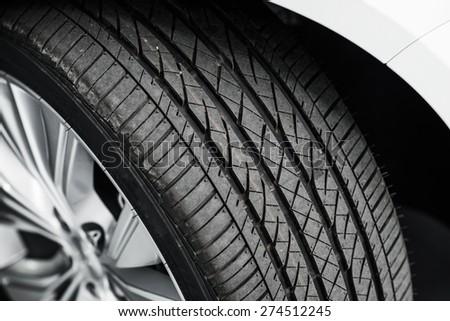 Brand New Car Tire Closeup Photo. Modern Car Tire - stock photo