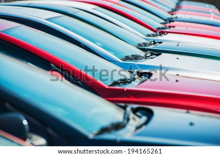 Brand New Cars in Stock. Dealership Vehicles Lot. New Cars Market. - stock photo
