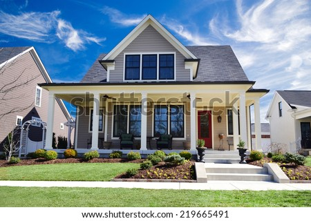 Brand New Custom Dream Home with Huge Front Porch and Beautifully Landscaped Yard - stock photo