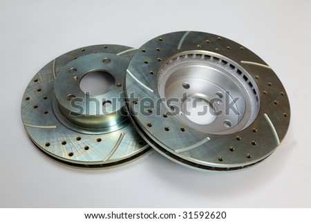 Brand New drilled and slotted brake rotors - stock photo