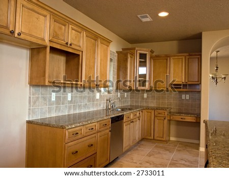 brand new empty kitchen waits for its new owners - stock photo