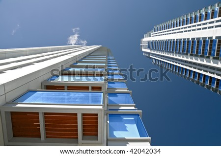 Brand new executive apartments. Modern, new executive flats and offices with deep blue summer sky and copy space.