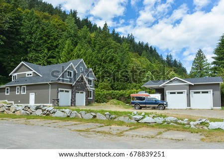 Brand New Family House With Car And Boat Parked On Gravel Driveway. New  Residential House