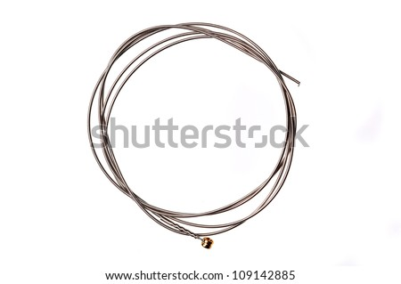 Brand new guitar string, isolated on white. - stock photo