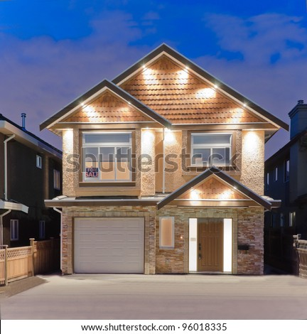 Brand new house for sale   in suburbs at dusk in Vancouver, Canada - stock photo