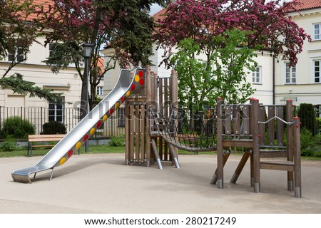 Brand new modern wooden and metal playground with slider and shaking bridge for children in Warsaw, Poland - stock photo
